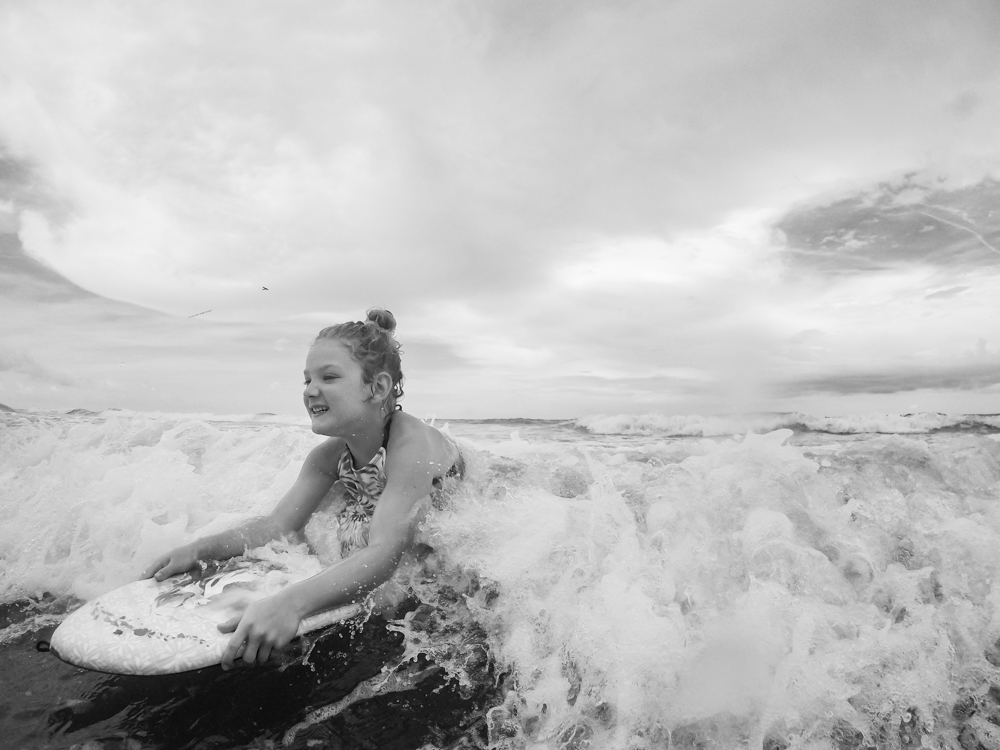 Ellie riding waves